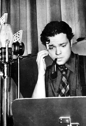 Orson Welles broadcast #1930s. Like his wide tie and suspenders.