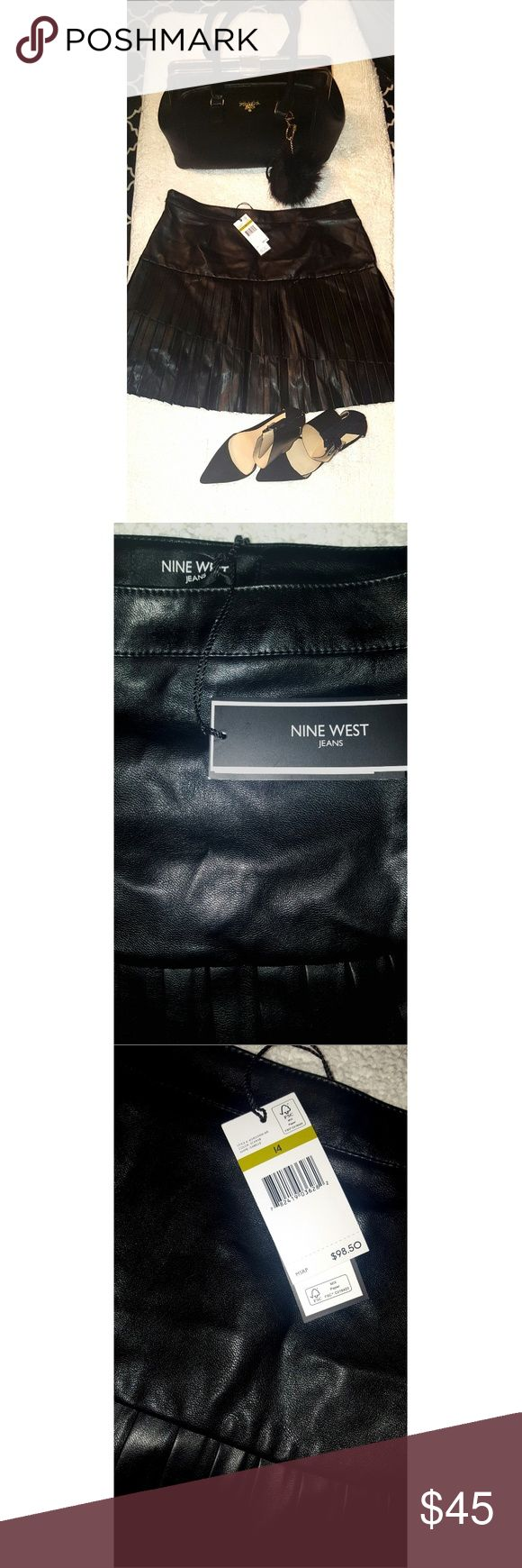 "PLUS SIZE FUNK LEATHER NINE WEST MINI SKIRT Sexy funk leather pleated nine West mini skirt is a size 14 but I think it run small more like a 12.. Waist 35""...length 18""...there is a lot of way to wear this beautiful skirt  Length 18"" Waist 35"" Nine West Skirts Mini"