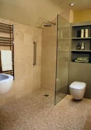 floating sink and loo, travetine tiling.