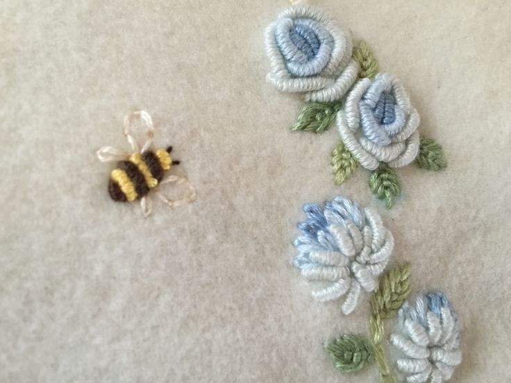 Hand Embroidery Embroidered baby blanket detail. Bullion roses and bumble bee