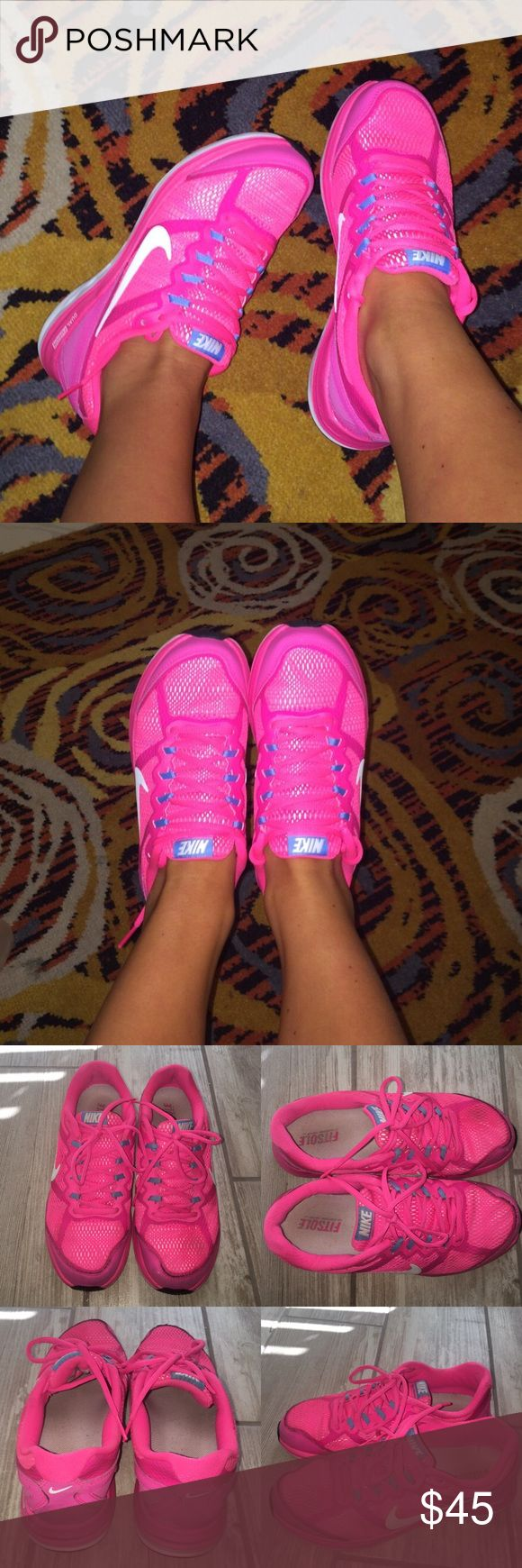 Pink Nike running shoes/sneakers, fitsole Really pretty bright pink Nike's. In good condition. Have some dog 🐶 bites as seen on the last photo. Nike Shoes Athletic Shoes