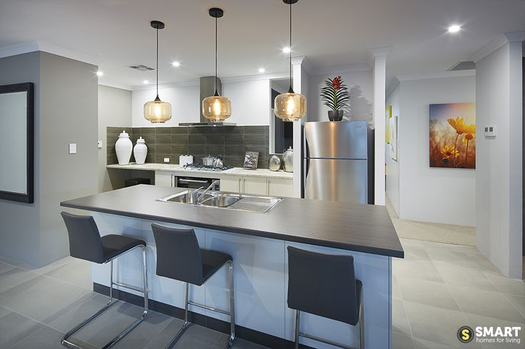 The Apex kitchen with gorgeous pendant lights and scullery.