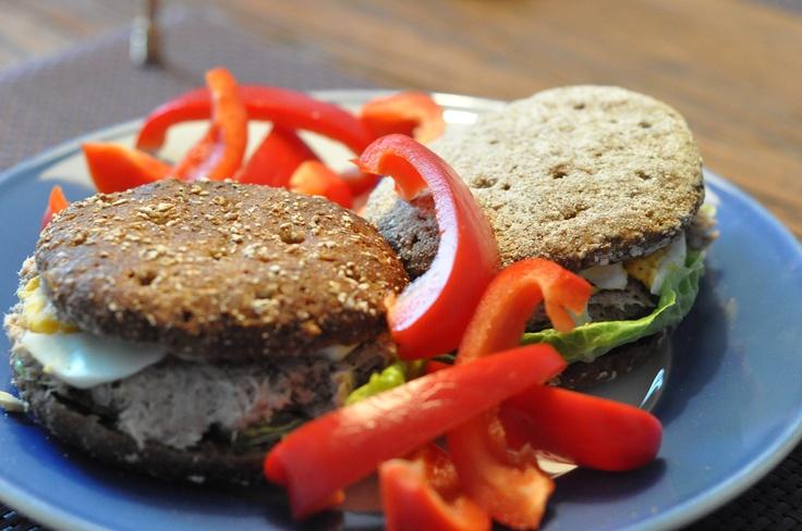 Tuna burgers w/ organic bread, tuna x goat cream cheese, eggs, roma salad. Bell peppers. Keeping it simple.