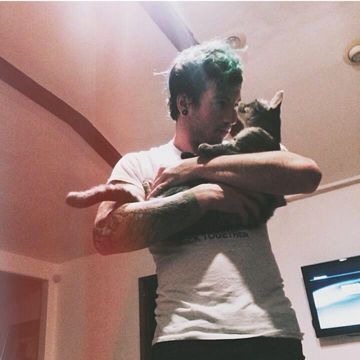 He's too adorable and the cat just makes him 4484585493829% cuter