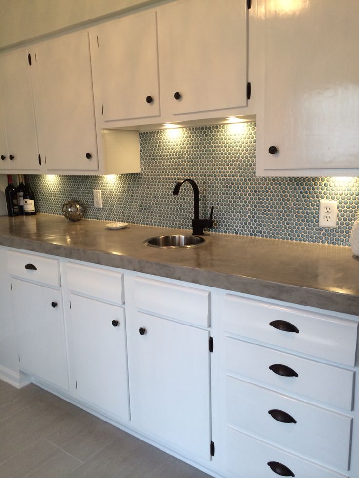 with diy cement countertop and porcelain mosaic penny tile backsplash
