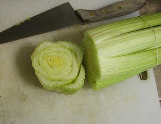 Regrow Celery  Using a large knife, cut the bottom off the stalk.