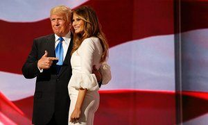 RNC in Cleveland 2016epaselect epa05431370 Donald Trump (L) escorts his wife Melania (R) after her speech during the second session on the first day of the 2016 Republican National Convention at Quicken Loans Arena in Cleveland, Ohio, USA, 18 July 2016. The four-day convention is expected to end with Donald Trump formally accepting the nomination of the Republican Party as their presidential candidate in the 2016 election. EPA/MICHAEL REYNOLDS