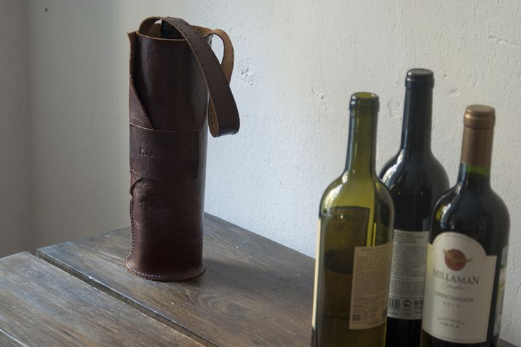 The leather carrier for a one wine bottle