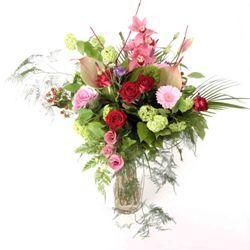 Extravagant Flower Bouquet Hand Tied in Glass Vase