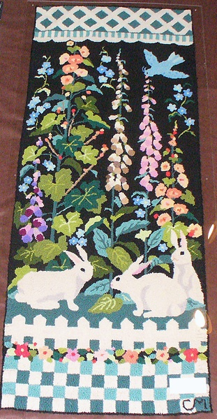 I found this Claire Murray rug at the Clovis antiques fair - it matches a larger one I already own. So cute!