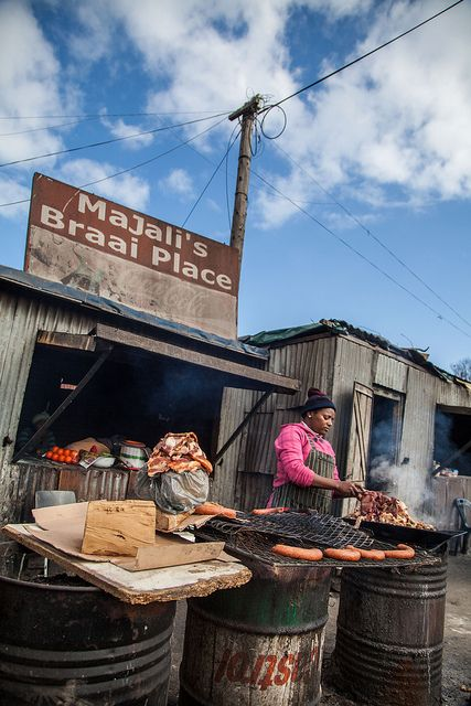 Braai's (barbeque) are common in South Africa and the townships such as Khayelitsha in Cape Town, are no exception. For a few rand, you can get a various assorment of sausages and meats cooked right on the spot. Photo by Jake Salyers