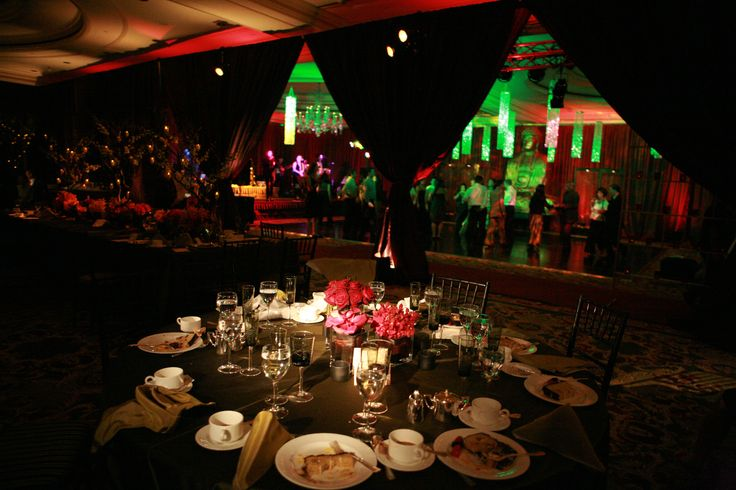 Enhanced Lighting divided the Ritz SF Ballroom into two sections using drapery.  The dining area was draped with Egg Plant Taffeta and the dancing area (revealed after dinner) was draped with Red Silk Trevira.   Pinspotting, uplighting, led chandeliers were all installed by Enhanced.