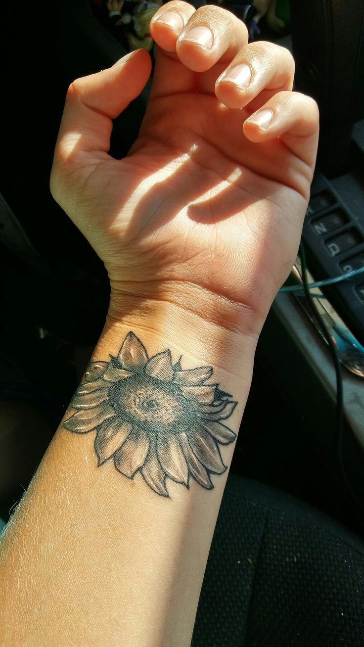 My beautiful black and gray sunflower on my left inside wrist.