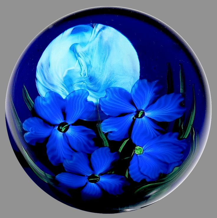 """Paperweight by Steven Lundberg Glass Art 1997 """" Ba Loo"""" poppies and full moon compound paperweight, by Justin Lundberg. Four dark blue poppies grow on stems with long green leaves below a marbled, light blue full moon in a dark blue night sky. Signed/dated. Diameter 3 7/16"""", 28oz"""