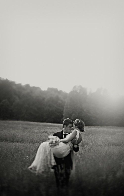 i want a pic like this of him carrying me over the door step..except we will be leaving to travel not buying a house..hmmm