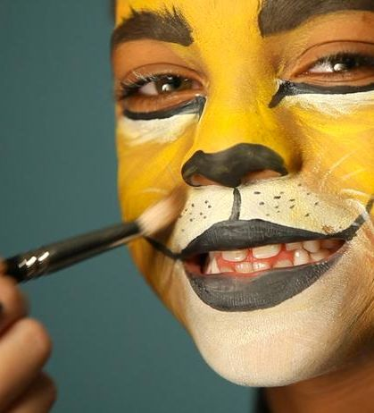 Kids Halloween makeup tutorial for a lion