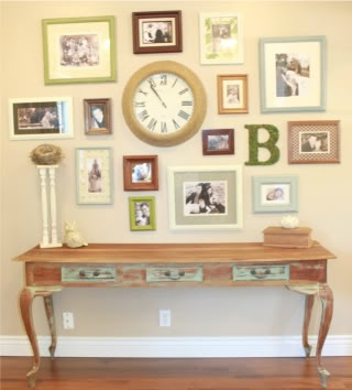 Picture frame wall idea. I have a large clock in the middle of my wall and nothing around it...maybe this could work?