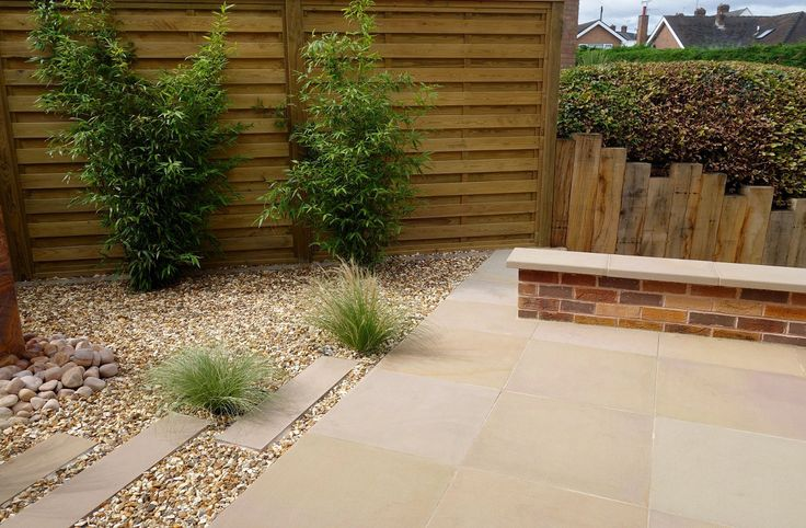 After Redesign & Landscaping - sawn sandstone patio, stone plank detailing in gravel & wall coping, garden privacy screens, bamboo, grasses, contemporary garden, low maintenance garden