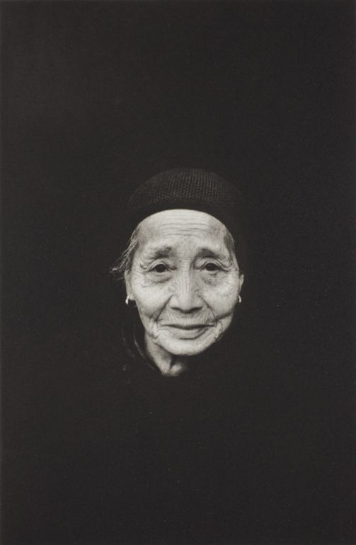 FAMAG 2008.26.3 | Arnold, Eve (1912-2012): Retired Worker, Guelin, China, 1979, printer: Stoneman, Hugh (1947-2005), publisher: Hugh & Linda Stoneman with Michael Ward, signed and dated 2002, photogravure etching (artist's proof) published 2002, 35.5 x 25.5 cms. The Art Fund Hugh Stoneman Archive. © Eve Arnold & Magnum Photos. | The Permanent Collection | Falmouth Art Gallery