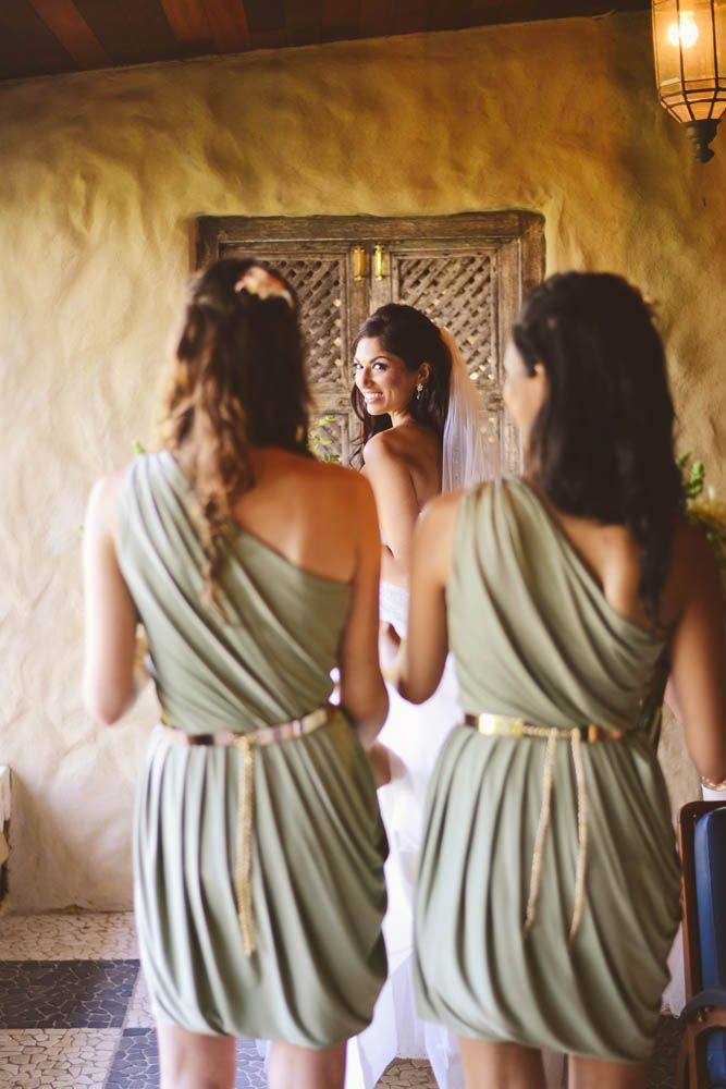 The bridesmaids dresses had gold belts that accented the sage dresses and completed the colour scheme.