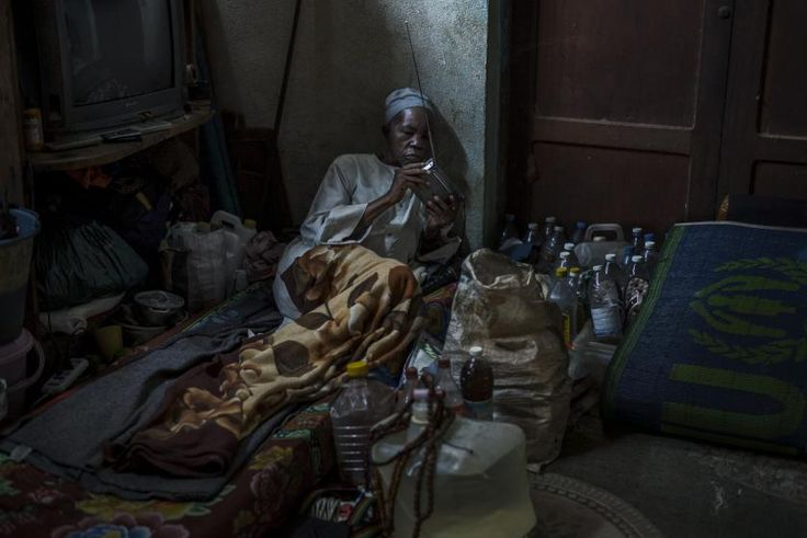 A man listens to his radio in a building situated in the compound of the church of Carnot, Central African Republic, Oct. 18, 2015. About 500 muslims have been living there for 22 months with little access to food and health care.