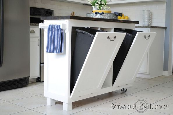 Betcha didn't realize this island used to be kitchen cabinets. Trash cans fit snugly inside on hinged doors with a hook that connects to the top to the interior cabinet — preventing your doors from falling open and spilling the trash on the floor. See more at Sawdust 2 Stitches »  - GoodHousekeeping.com