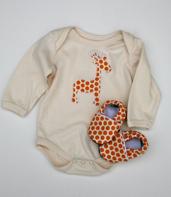 LONG sleeve Giraffe Organic Bodysuit in Orange Spots with Matching Handmade Organic Baby Shoes.  Love these cute little onesies for a newborn.  Comfy when they are tiny!  :)