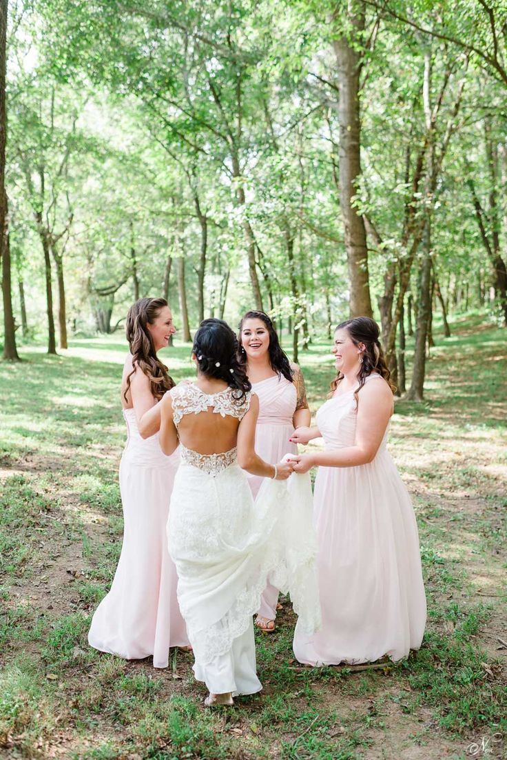 bride and bridesmaids dancing in the forest at Hiwassee River Weddings