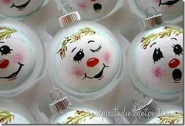 Cute hand painted snowman ornaments. Maybe do these on old light bulbs?
