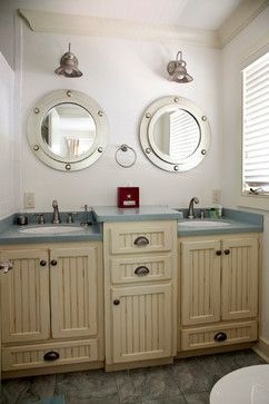 Nautical bathroom.  I don't really like this bathroom, but I like the idea of a nautical bathroom with a single sink/mirror/light fixture.