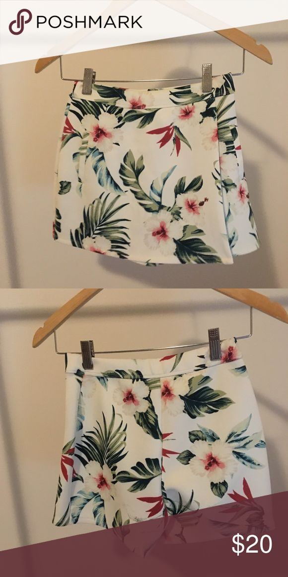 Hollister skirt/shorts Floral Hollister skort perfect for vacation  Worn 2x Has black stain on middle back but can't tell with design - not sure if stain  Great condition. Scuba material Hollister Skirts