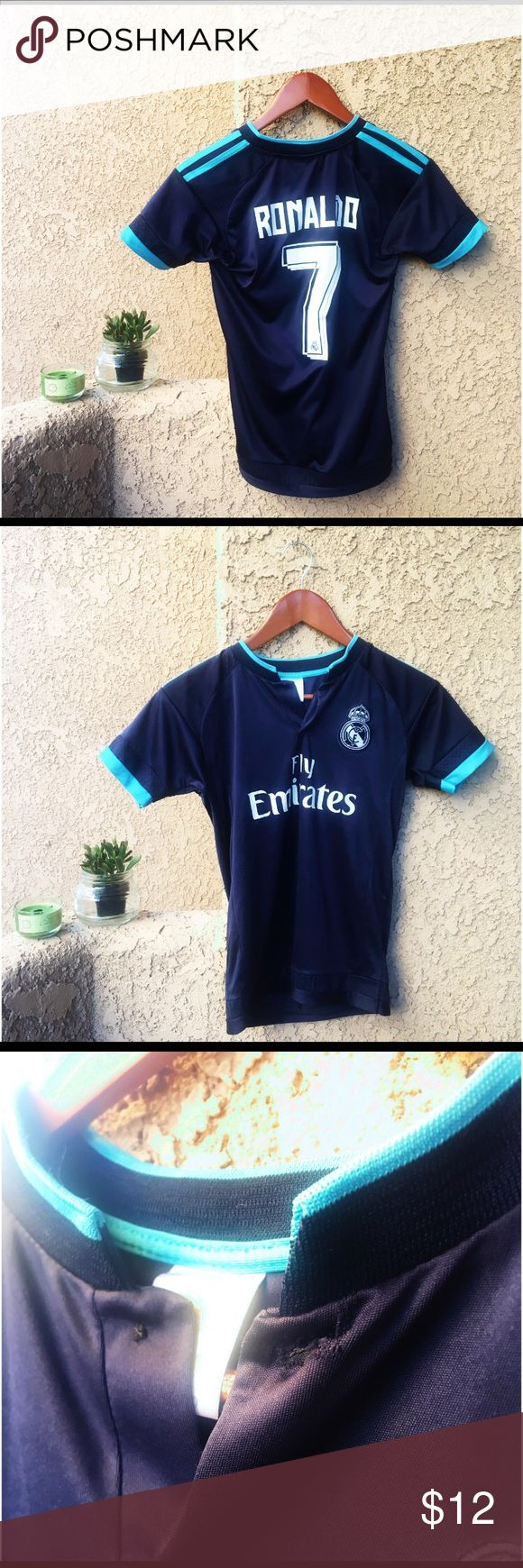 Women's Real Madrid Ronaldo Soccer Jersey Women's Real Madrid Ronaldo jersey. Material: 100% micro. It is in good, used condition. There is very minimal cracking on the lettering (won't be able to see it unless you're looking close). It is missing the button at the neck, however I do have an extra button that I can include in the package. You will need to sew it on yourself if desired. Tops Tees - Short Sleeve