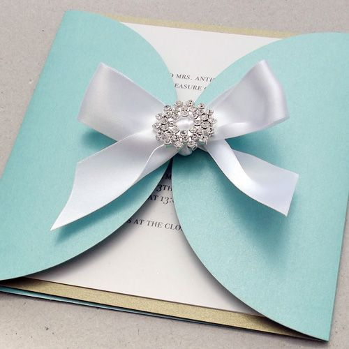 Brooch wedding invitation that also acts as a gift. How about a beautiful diamonté brooch which is hand tied to the front of your wedding invitation.