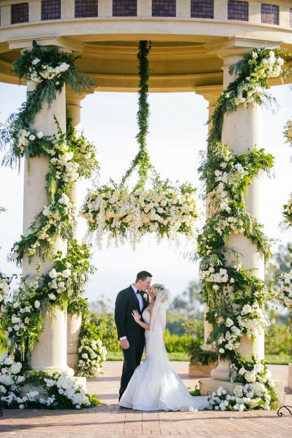 An Intertwined Event: Tuscany-Inspired Pelican Hill Wedding ; Wedding Ceremony, Luxury Wedding, Greenery, White Floral Arrangements, White Wedding, Bride and Groom