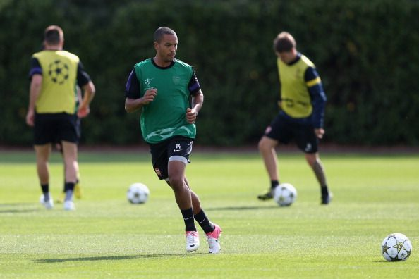 Theo Walcott of Arsenal passes the ball during a training session at London Colney on September 17, 2012 in St Albans, England