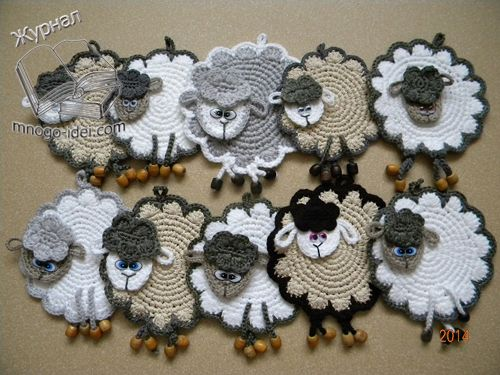 Crocheted lambs with beads.