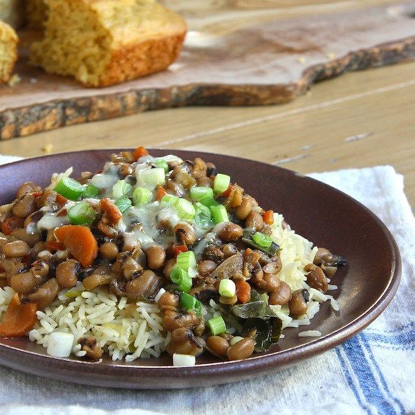 Hoppin' John, a traditional southern black-eyed pea stew with collard greens for a lucky new year.  Black-eyed peas, black-eyed beans, black-eyed bean, rice, collard greens, vegetarian,