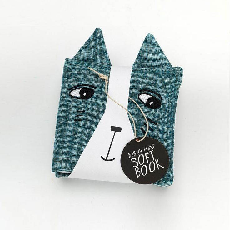 Cloth book - illustrated with high contrast black and white bold lines.