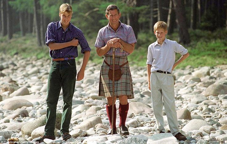 Having fun: Prince Charles with the Duke of Cambridge and Prince Harry during a family visit to Balmoral. During the trip, they went fishing on the River Dee