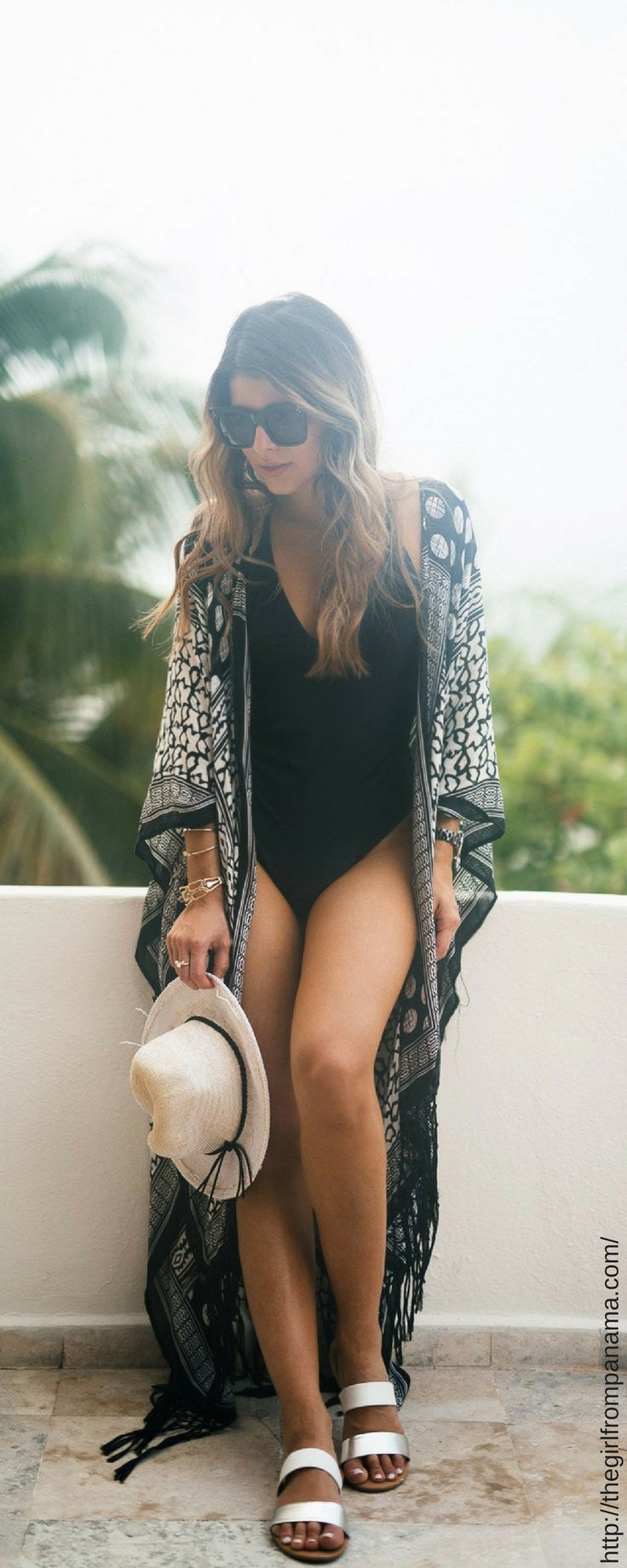 Insanely Flattering One-Piece Swimsuits Under $50 - Looking for the perfect one-piece for Spring Break or your next vacation? These simple suits will have you walking the beach in style!  Womanista.com