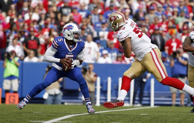 Bills vs. Dolphins:    October 23, 2016  -  28-25, Dolphins  -      Buffalo Bills quarterback Tyrod Taylor (5) looks to throw a pass while avoiding a tackle by San Francisco 49ers outside linebacker Aaron Lynch (59) during the first half at New Era Field. (Timothy T. Ludwig | USA TODAY Sports)
