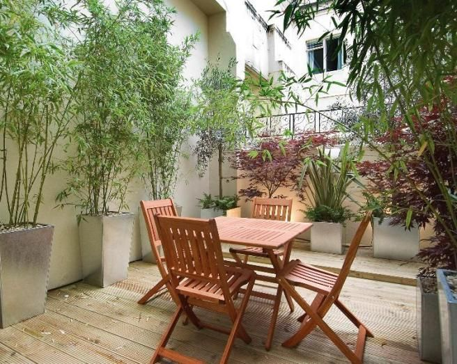 photo of bamboo pots garden and deck decking garden furniture urban garden