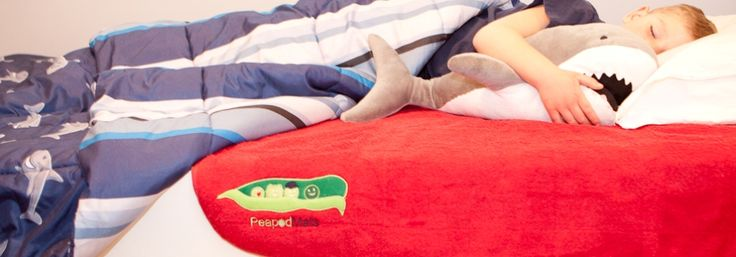 """PeapodMat - waterproof bedding and mattress protector for the older child for those """"oopsie"""" moments. Colour: Rebel Red"""