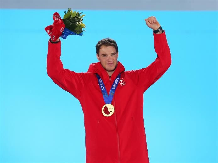 Gold medalist Dario Cologna of Switzerland celebrates during the medal ceremony for the Cross Country Men's 15km Classic event