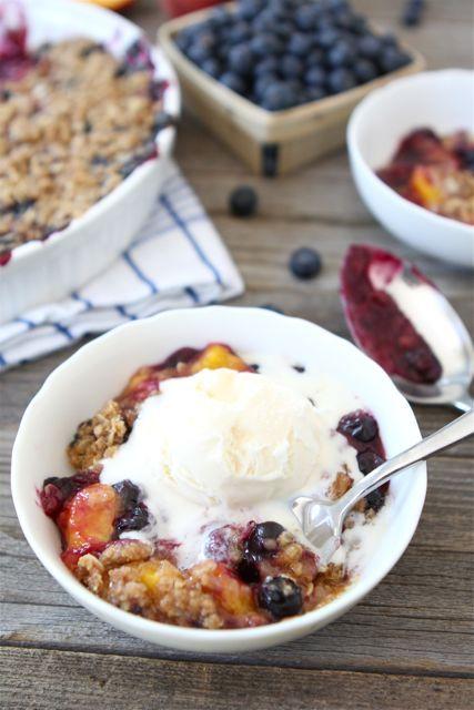 Blueberry Peach Crumble Recipe on www.twopeasandtheirpod.com. A MUST make summer dessert! #blueberry #peach