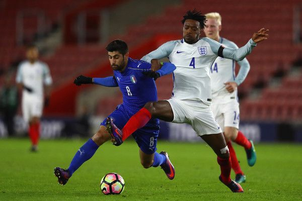Nathaniel Chalobah of England challenges Marco Benassi of Italy closes in during the FIFA 2018 World Cup Qualifier between England and Italy at St Mary's Stadium on November 10, 2016 in Southampton, England.
