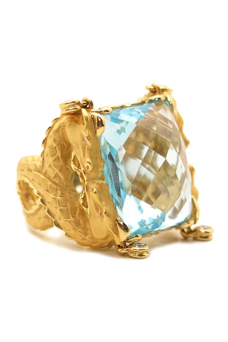 "Carrera y Carrera's lovely 18k yellow gold size 6 ""Nankin"" ring set with a 31.88ct faceted blue topaz and .18ctw diamonds. Available at Oster Jewelers."