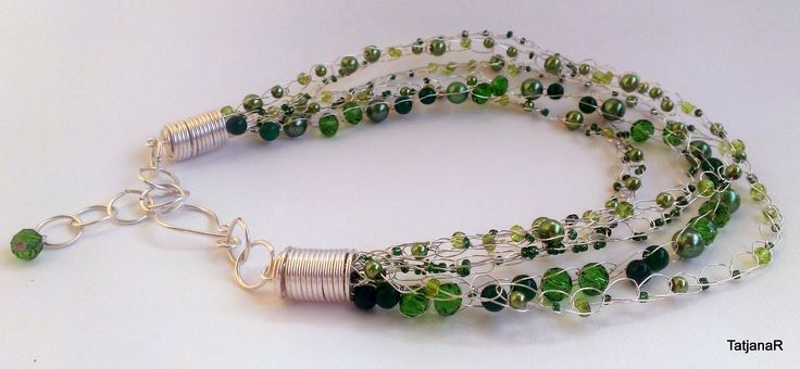 Crochet necklace with silver pleated cooper wire, glass perals, swarovski crystals and green jade.