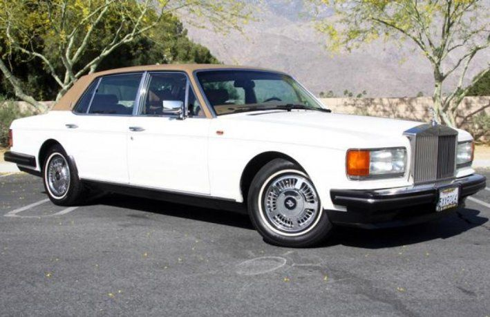 1991 Rolls-Royce, Silver Spur II  25900.00 USD  Well cared for Silver Spur II in Magnolia with a Tan interior 6.75 Liter V8 engine coupled to a 3 speed gearbox. Air conditioning, Power steering & brakes, Cruise control, Power windows & Door locks, Full instrumentation, Power bucket seats with memory, Remote mirrors, AM/FM CD & cassette stereo, Picnic trays, Nice woods, Leather, and more... Successor to the Silver Spur. The ..  http://www.collectioncar.com/detailed.php?ad=51427&ca..