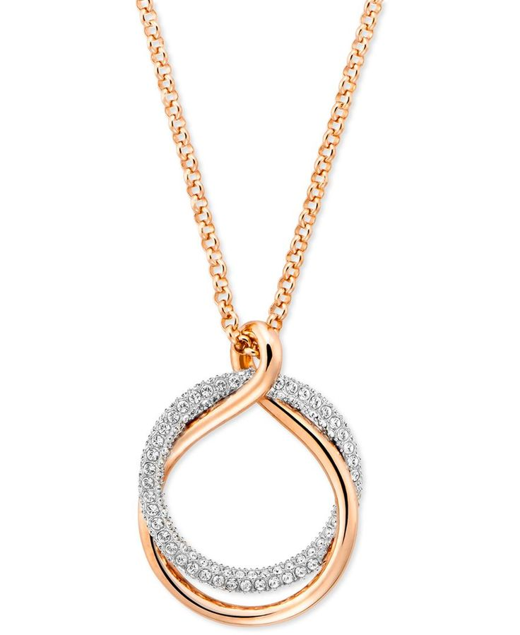 One gleaming metallic ring is intertwined with another encrusted with sparkling pave to create this spectacularly intriguing pendant necklace. Designed by Swarovski and available in rose gold-tone or